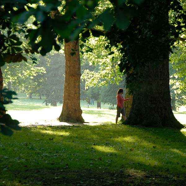 Woman walking in the trees in Finsbury Park North London