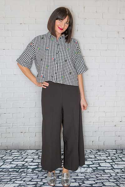 Melanie in Gingham Blouse and Black Wide Leg Trousers