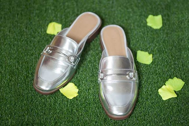 Silver mules on astro turf