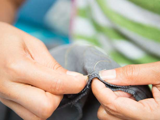 mending clothes before putting into storage