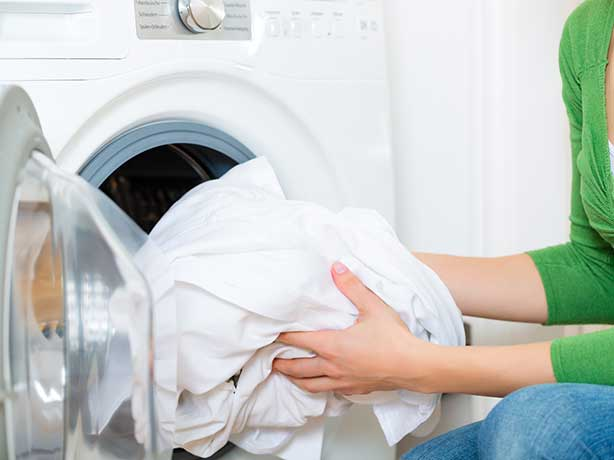 Washing clothes before putting into storage