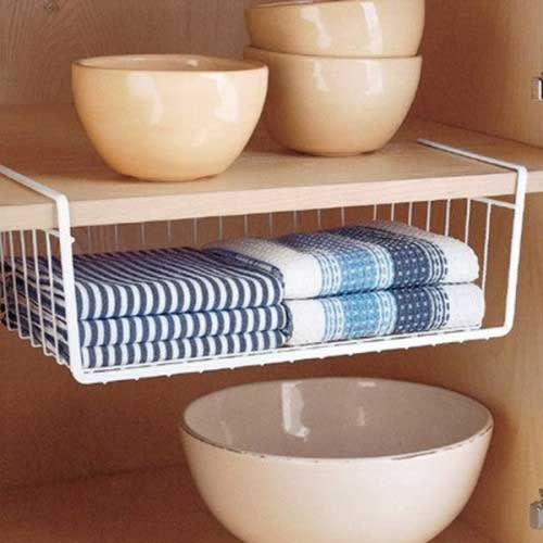 hanging storage basket in cupboard with tea towels