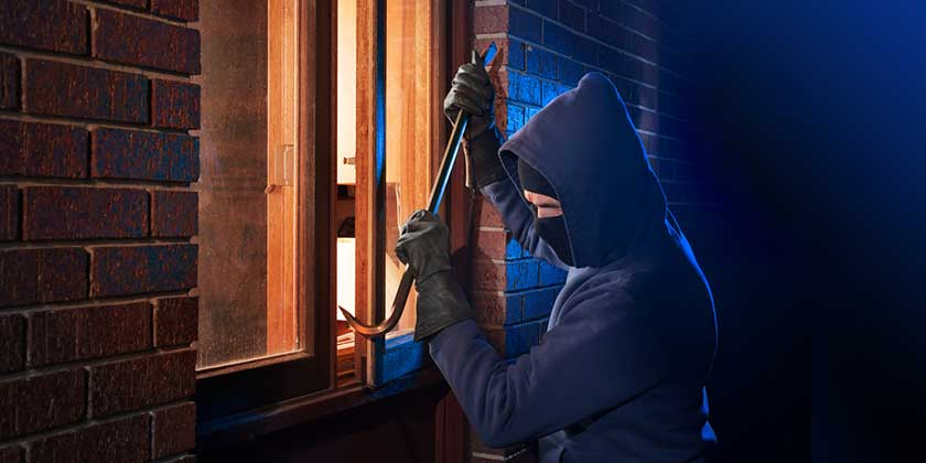 Burglar at Christmas breaking into house